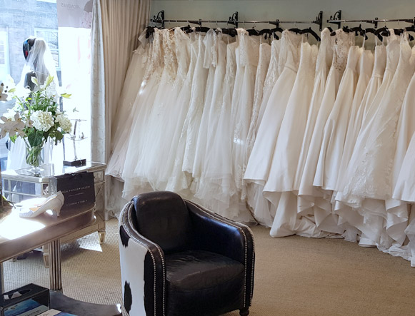 Our front room has a selection of accessories scattered throughout as well as three large rails of our beautiful bridal gowns. There are two comfortable seats for your guests to sink into while you try on dresses behind the luxurious draped curtains.