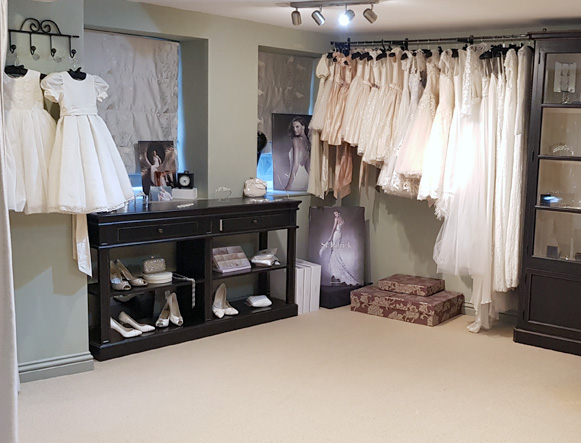 Our second large room is down a flight of stairs, we often use this room for dress fittings as there is plenty of space to move around and it is very private. There is also a selection of accessories and sale dresses in this room.