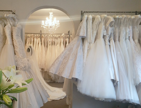 Our second room is full of our beautiful bridal gowns, with three long rails, there are plenty of styles to choose from! A large vintage style mirror sits on the back wall and there are two comfortable seats for guests. Our shop window is lovely to let in natural light but should you prefer a little more privacy we can always close our curtains.