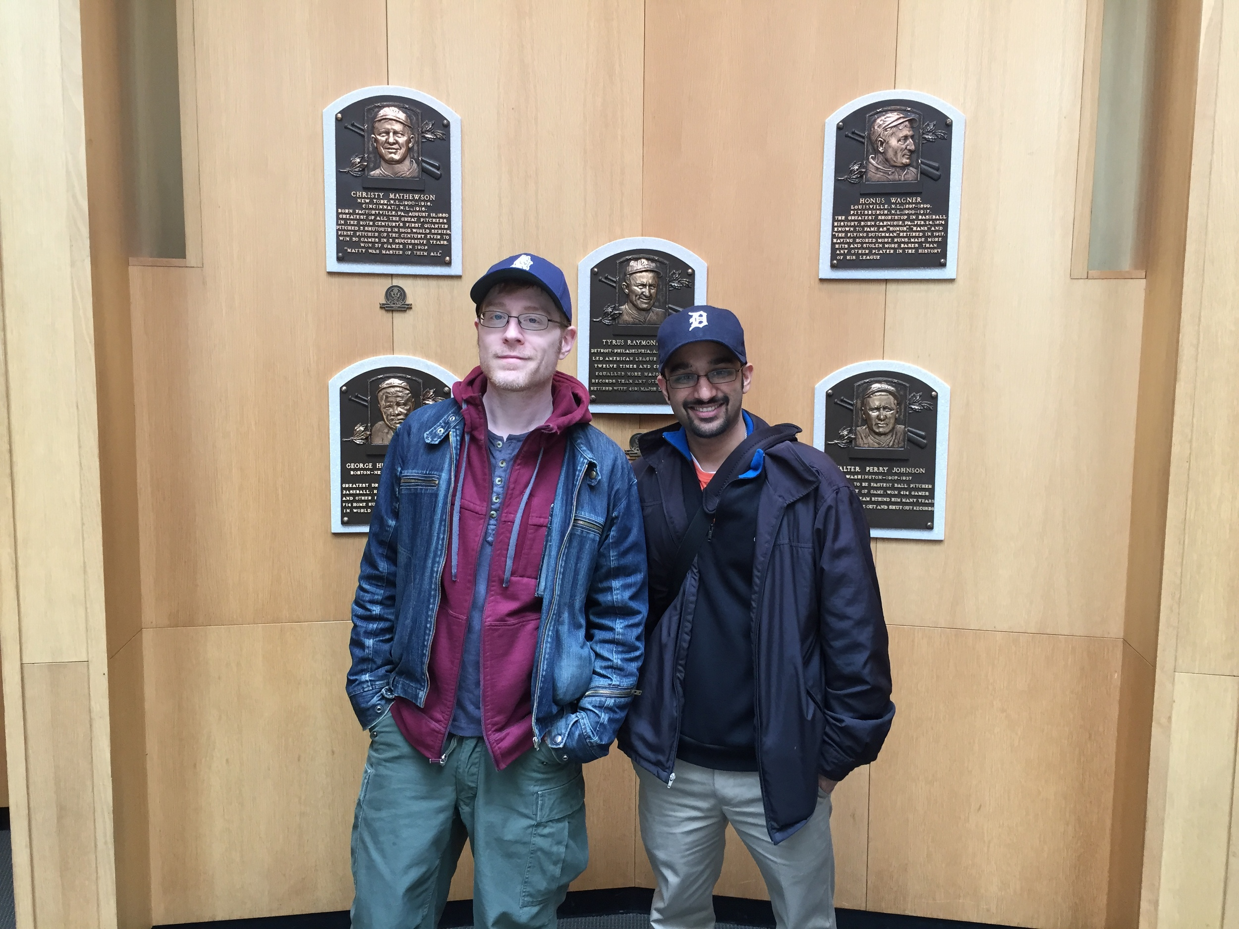 Anthony and Muneesh in front of the first Hall of Fame class' plaques.