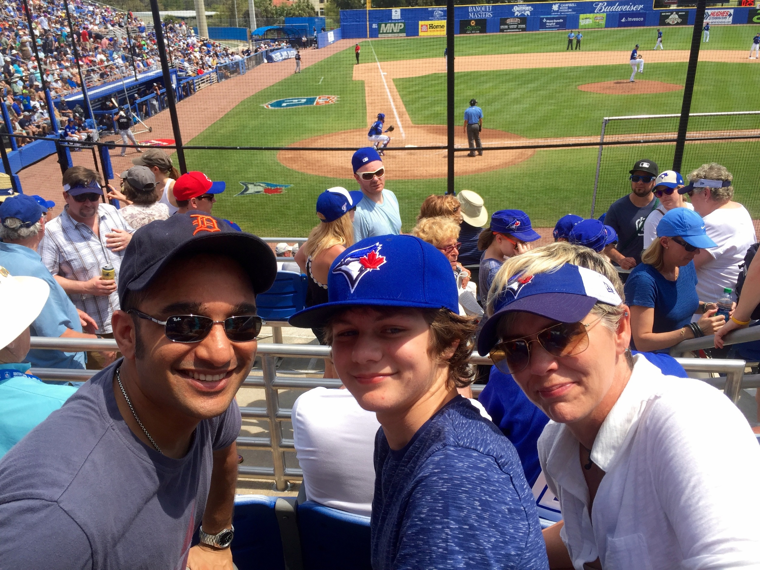Ty, Muneesh and Monique enjoying a Blue Jays Spring Training game in Dunedin.