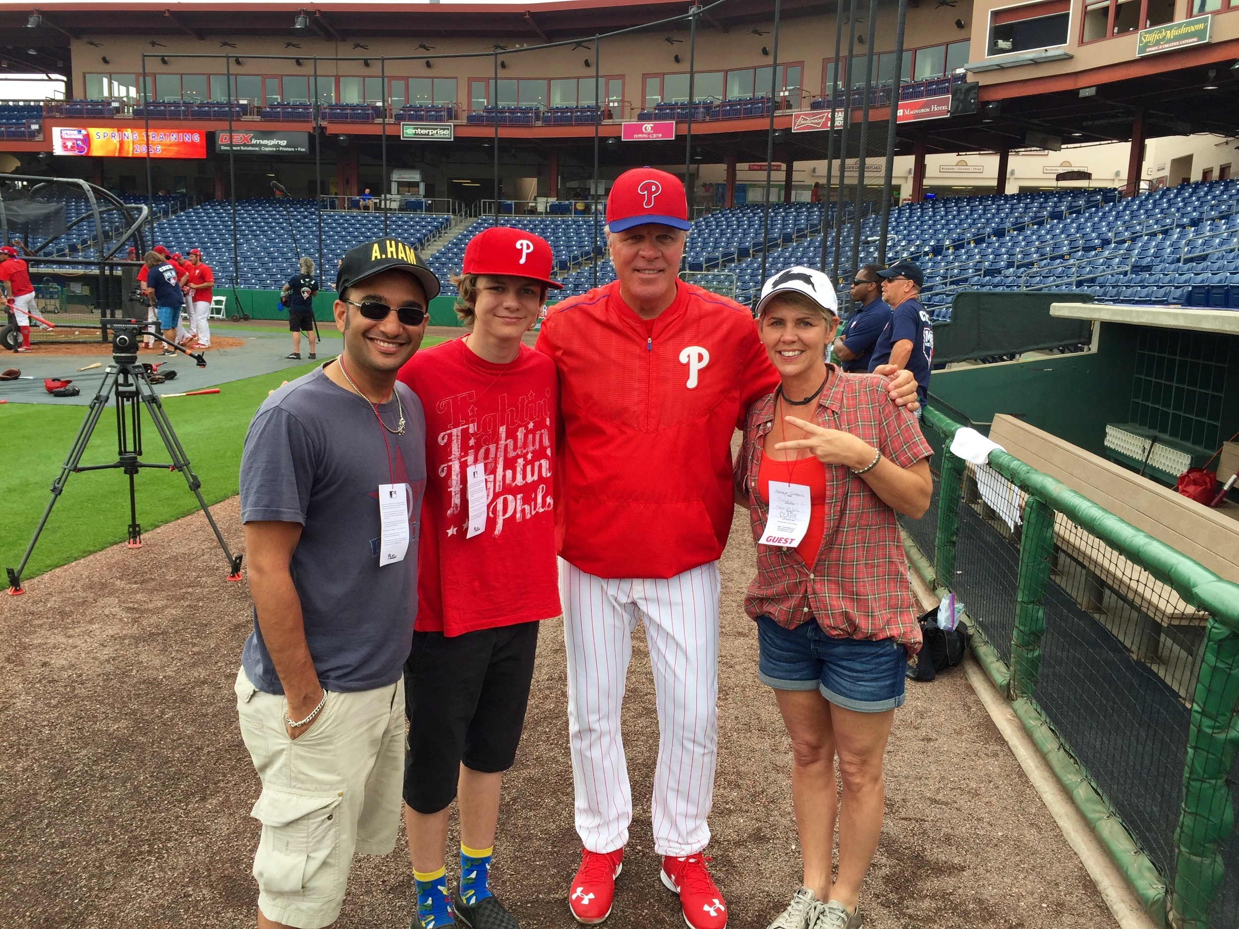 Ty, Muneesh and Monique with Phillies manager Pete Mackanin