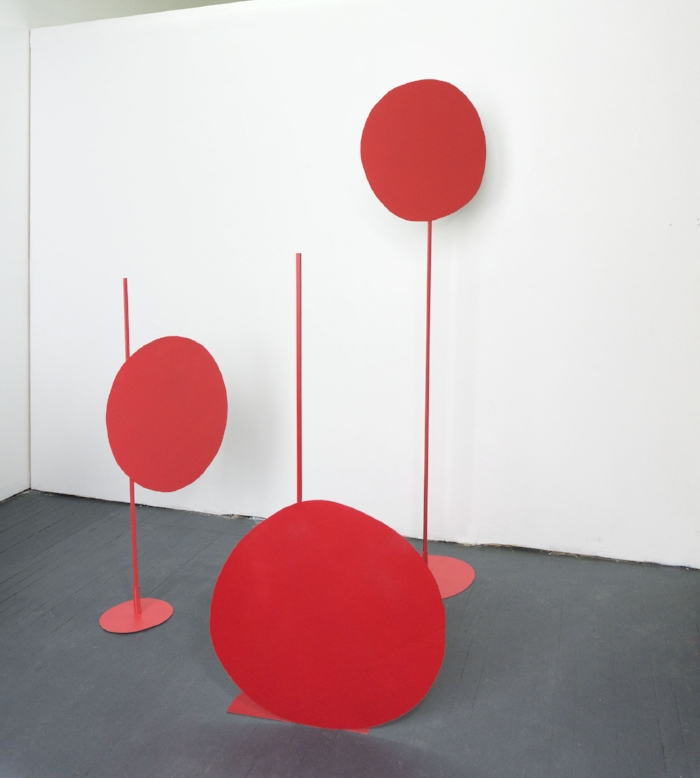 Three red dots, dimensions variable, metal, paint, 2017