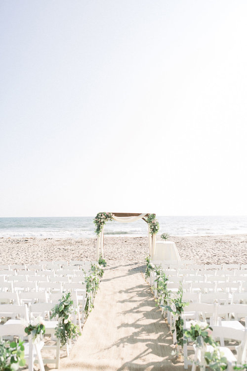 RBC Beach Ceremony Setup with White Folding Chairs