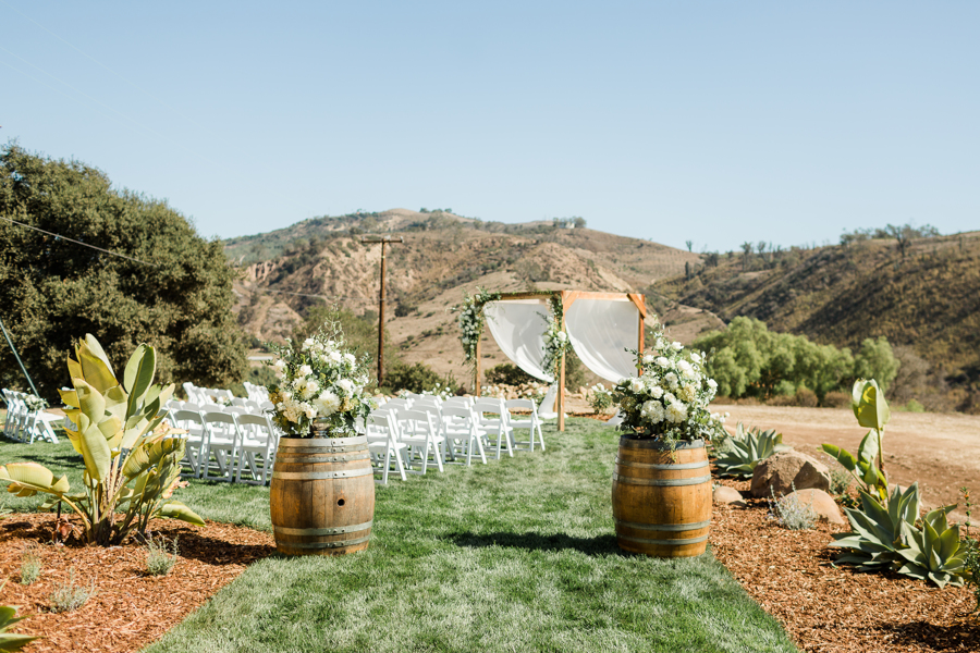 White Folding Chairs, Wine Barrel Entrance and Ceremony Cabana