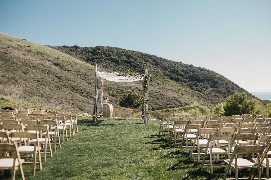 White Washed Folding Chairs and custom Birch Wood Ceremony Chuppah - El Capitan Canyon
