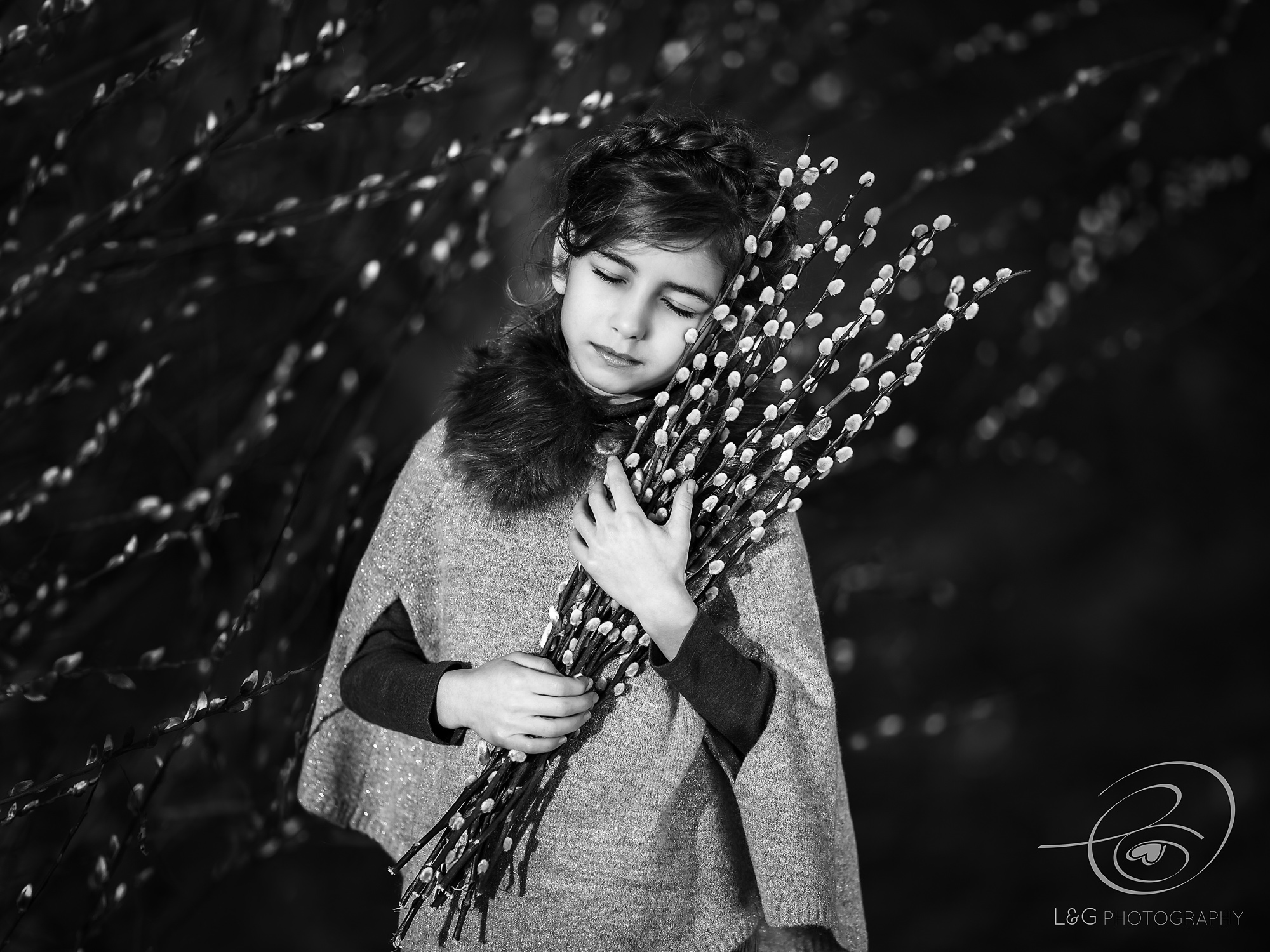 Girl with pussywillow in black&white