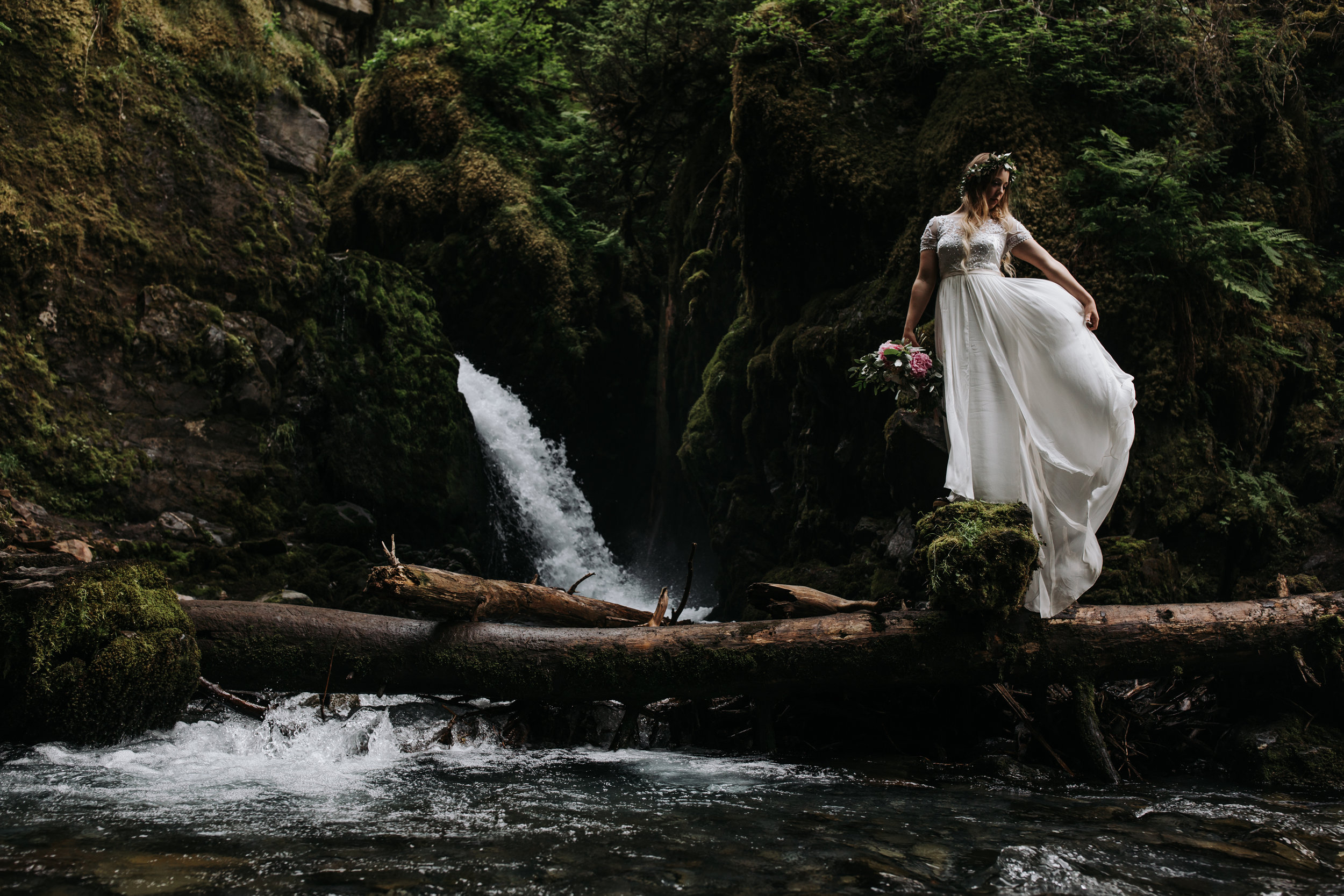 bride with waterfall in alaska