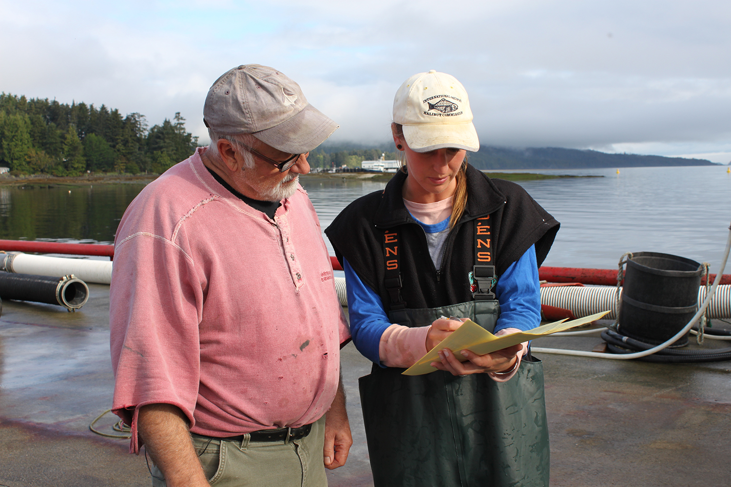 An IPHC port sampler interviews a wild Pacific halibut vessel master following a fishing trip.