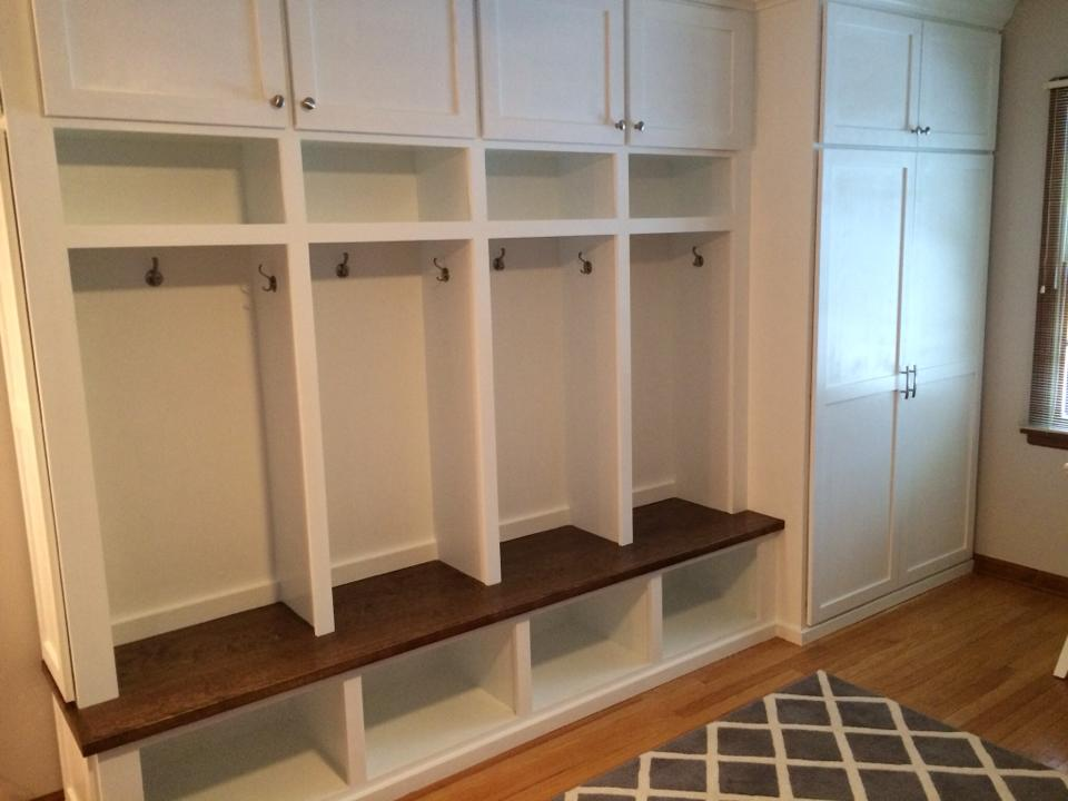 We had a serious storage problem on the main floor, so we added this bank of built-ins with a cubby for everyone and a large closet with shelving for art supplies and hanging space for coats.