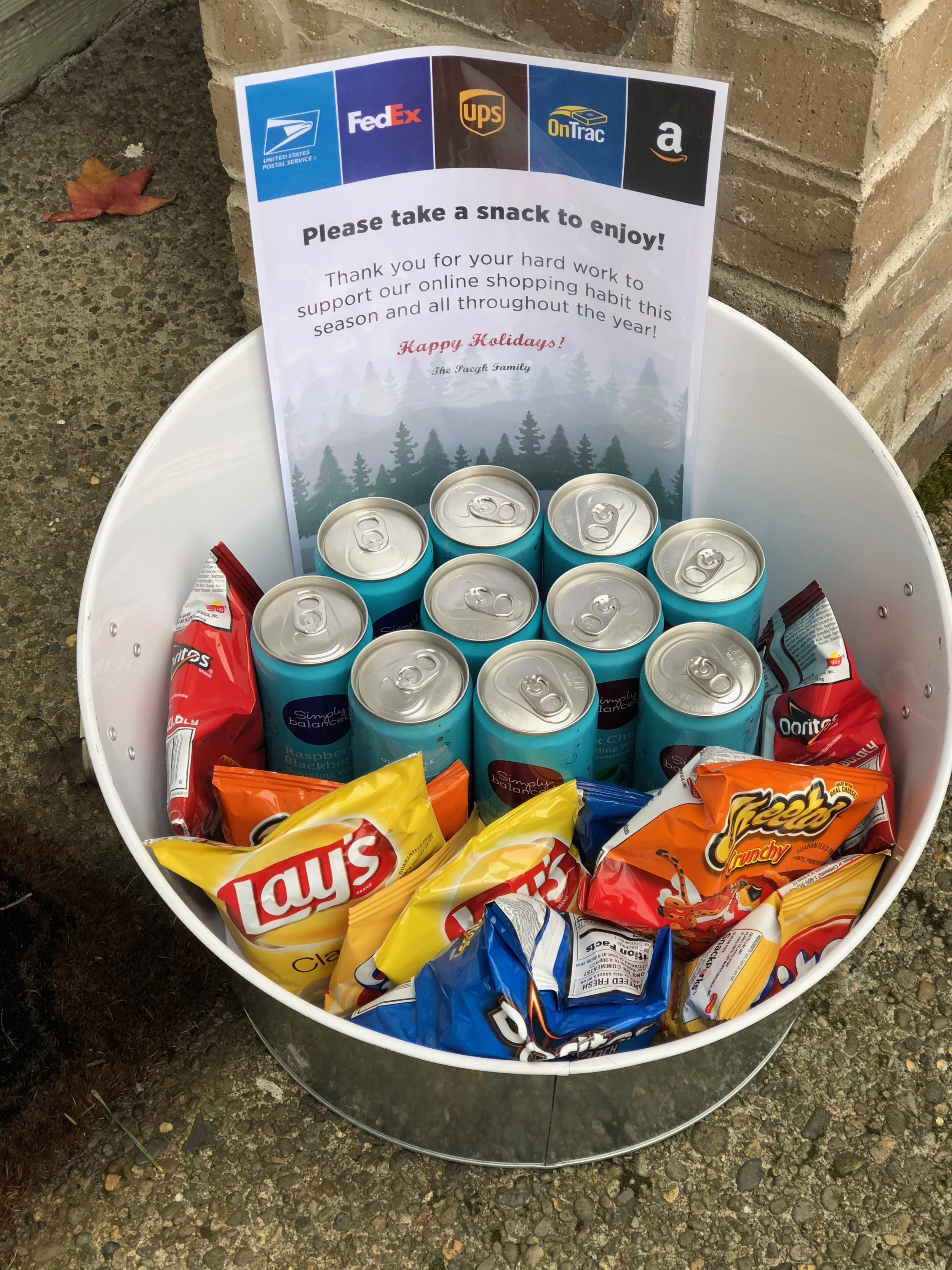 Add a cooler with drinks and snacks to your front porch to thank drivers for their hard work all year long.