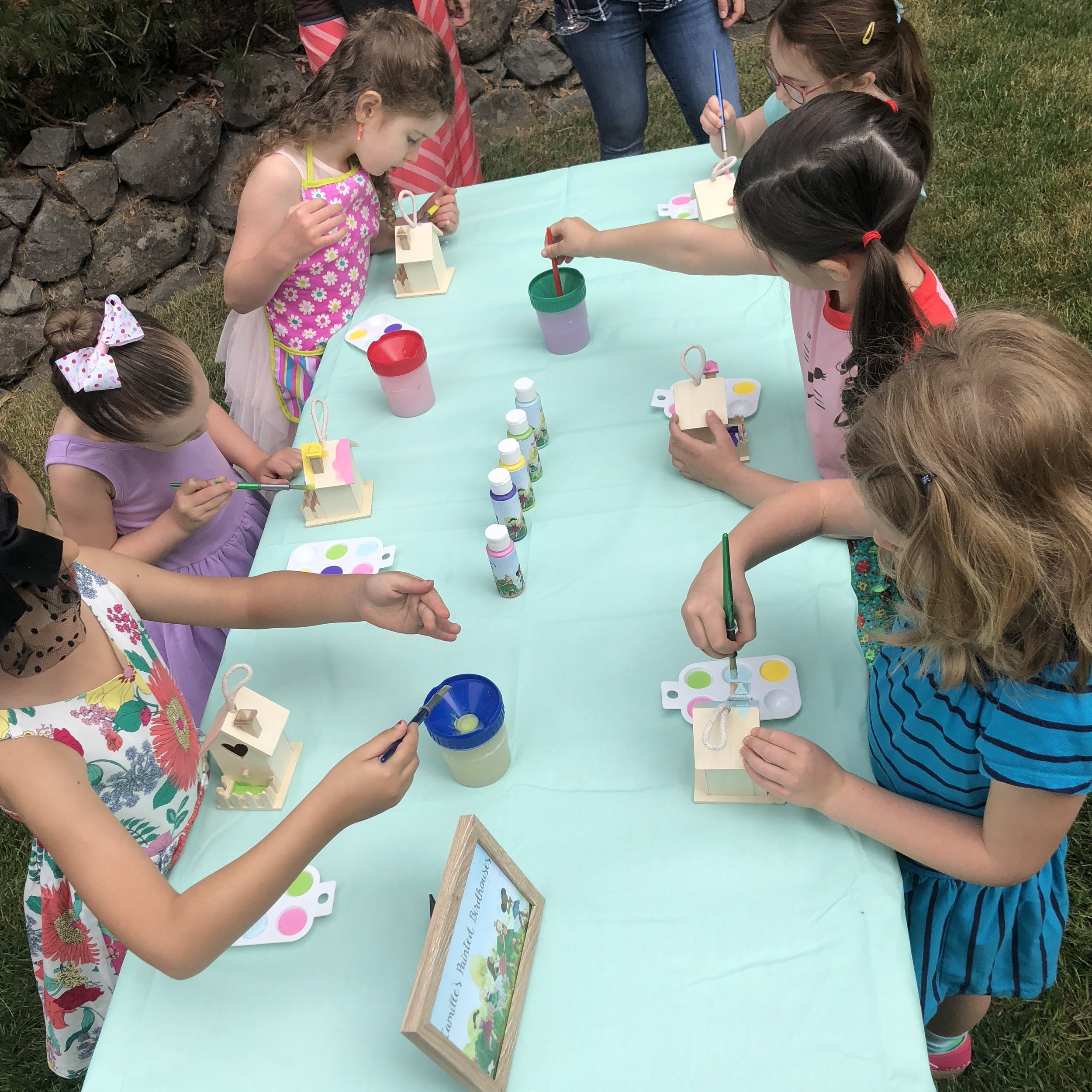 Party guests painted birdhouses at the first activity station.