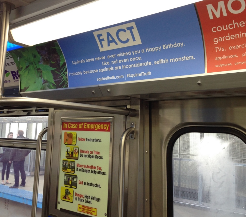 A #SquirrelTruth ad on the CTA Red Line in Chicago