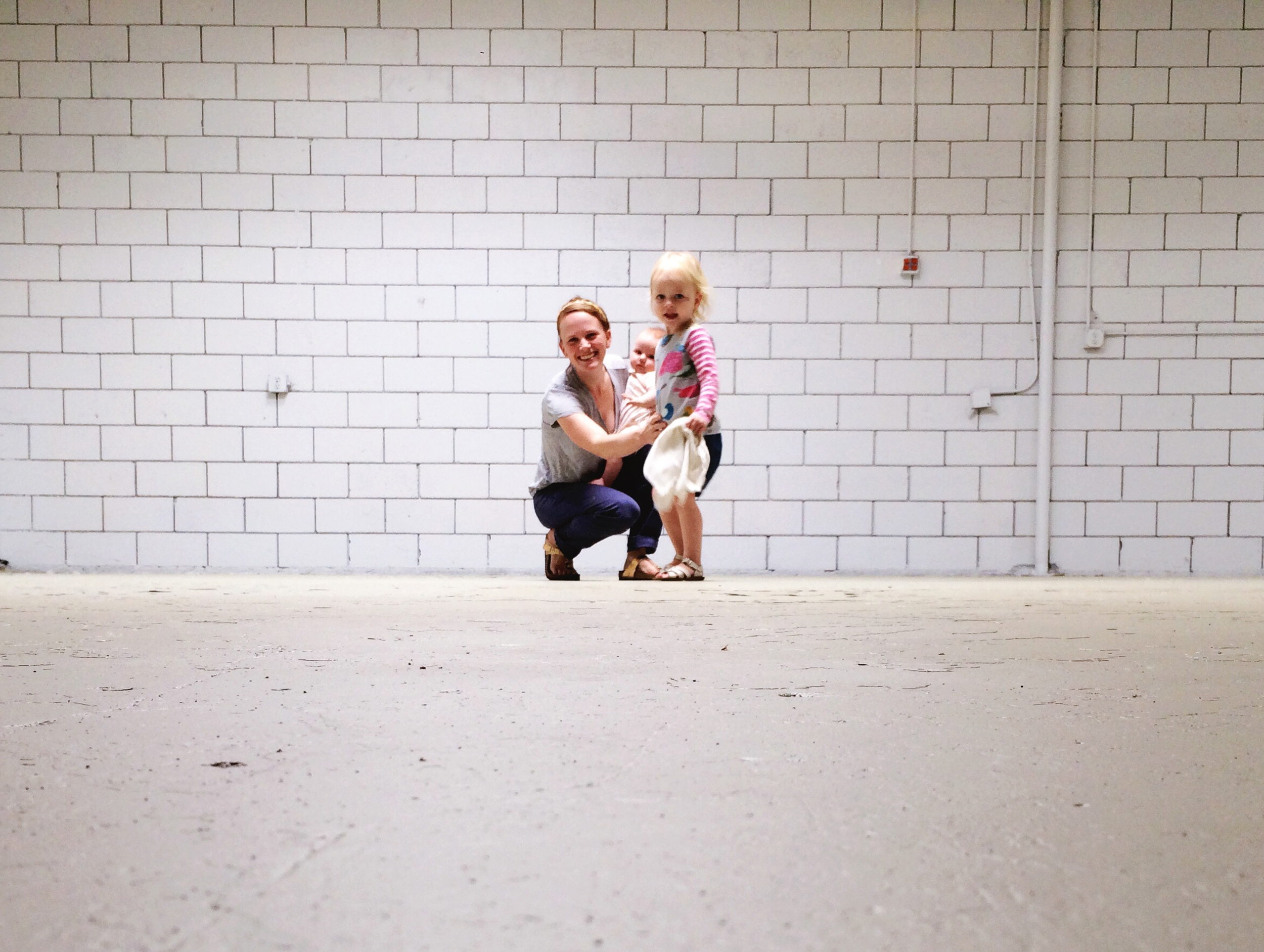 Elise and her daughters Ellerie and Piper in her new Get To Workbook warehouse space.