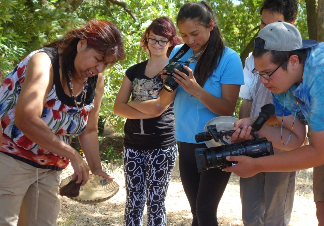Native youth, part of our Summer 2014 Media and Foodways Internship, film the process of sifting acorn flour.