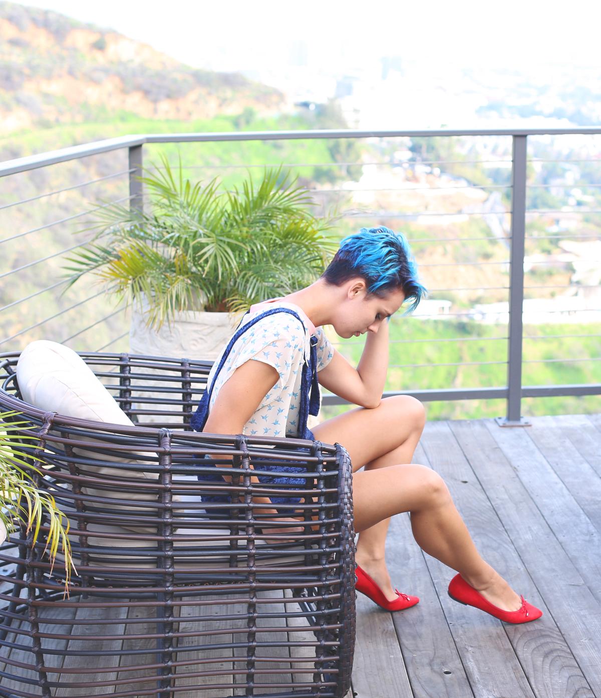 amy sitting overalls.jpg