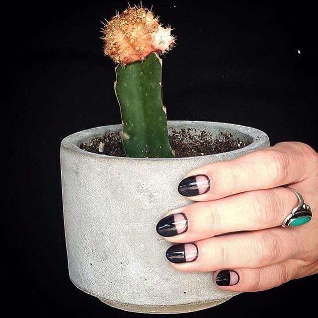 Black gel polish with negative space nail design
