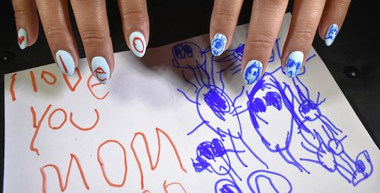 How cute is this? Our very own Carla had her nail art inspired by her son's drawing of their family.