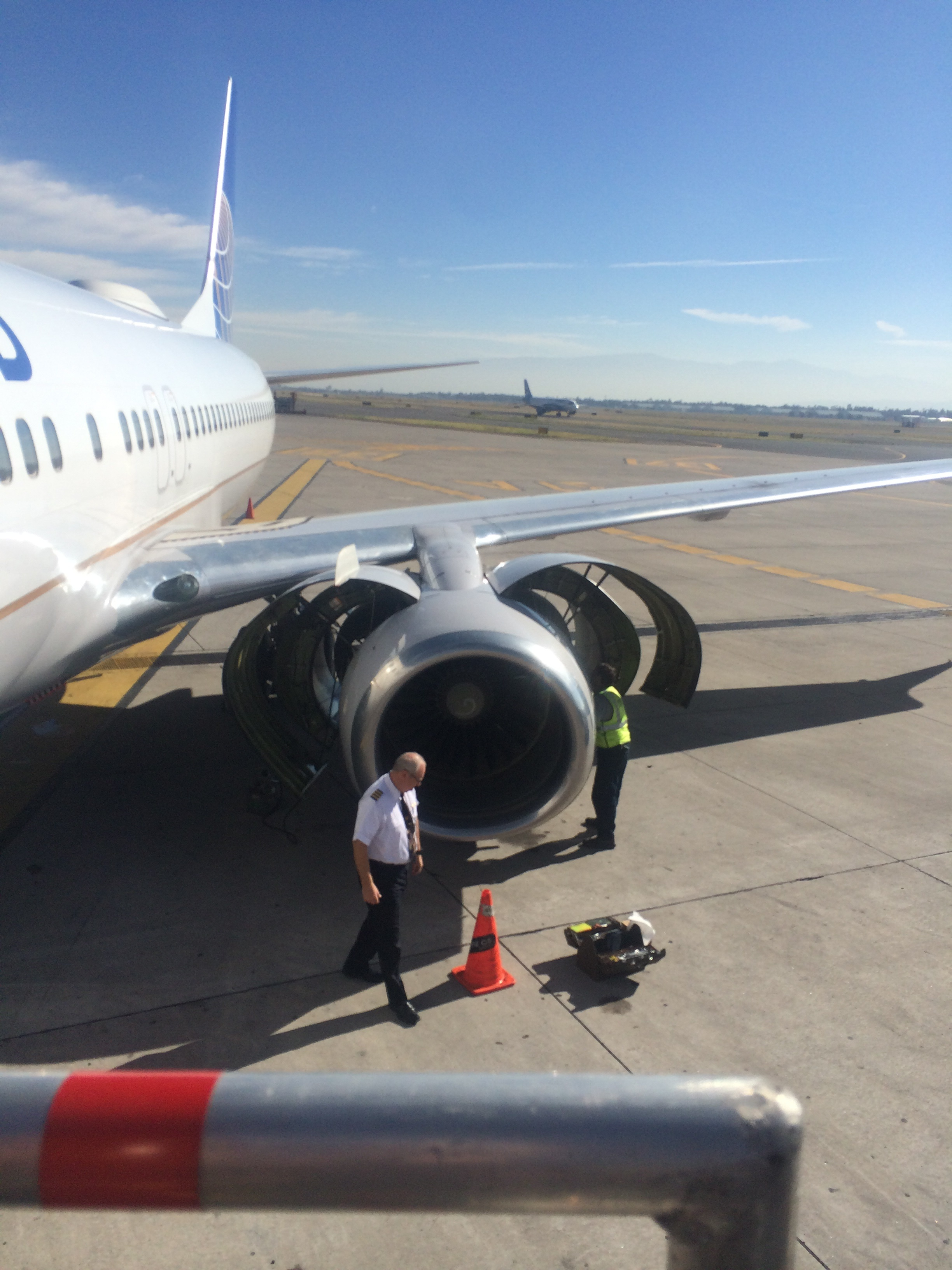 The pilot & airport maintenance checking the engine after we landed.