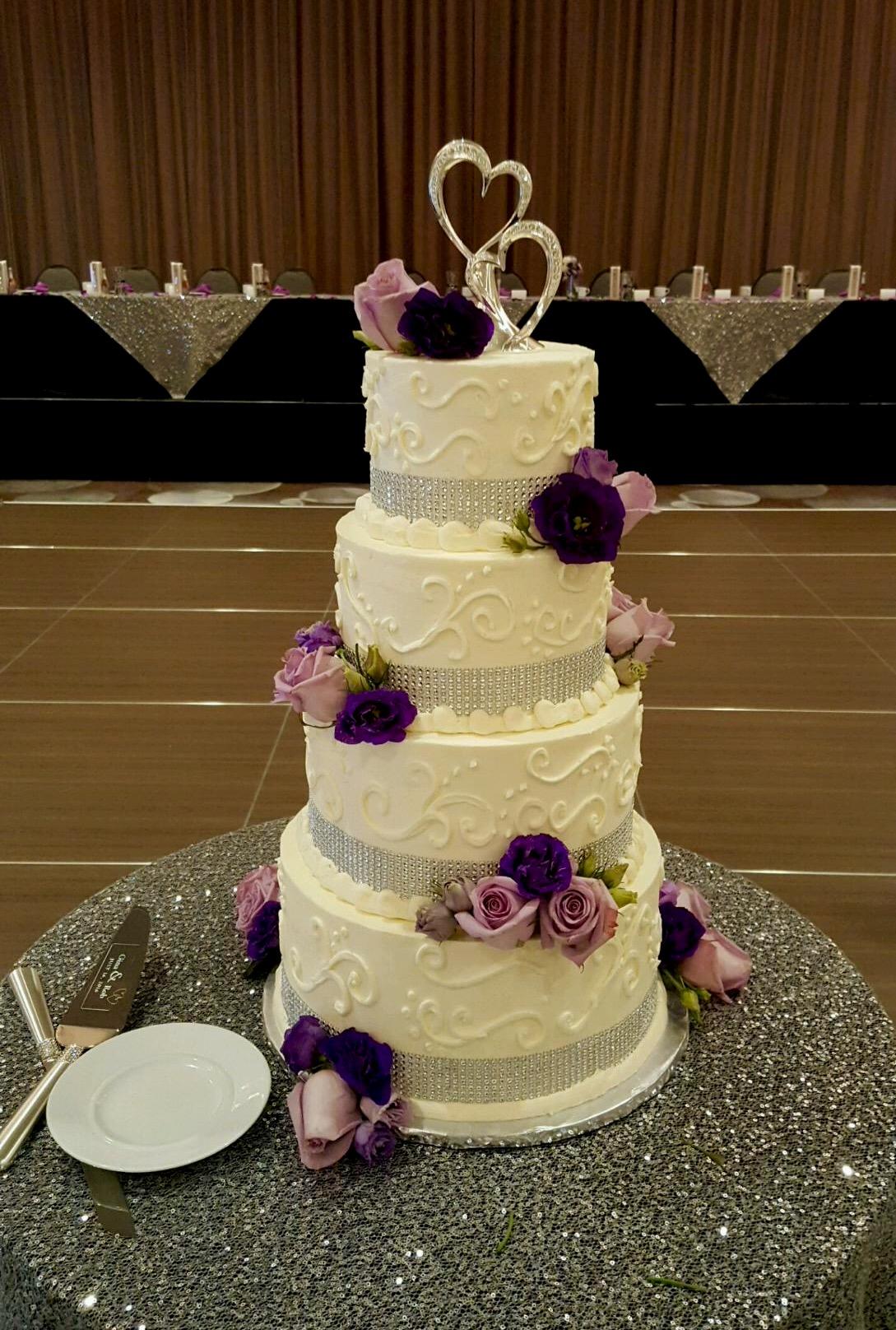 Wedding4tierwhitepurpleflowers.jpg