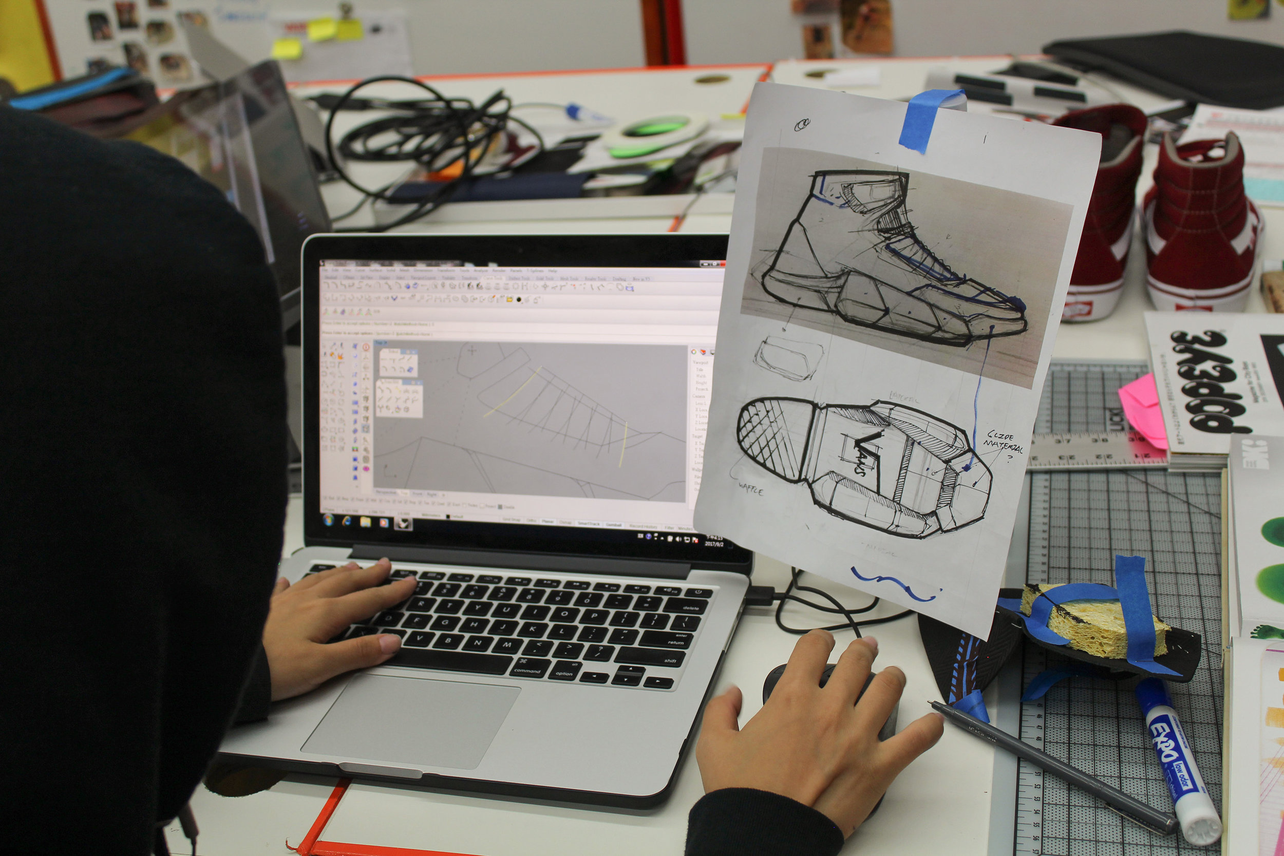 Pan starts her line drawing from the design sketches given by her footwear designer