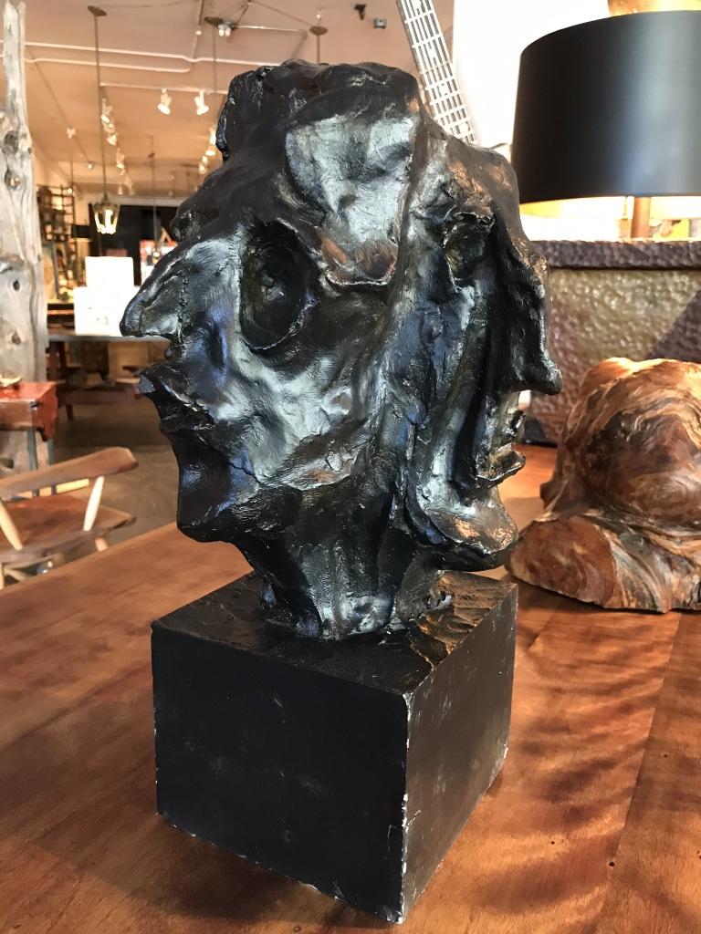 Black Four Face Sculpture
