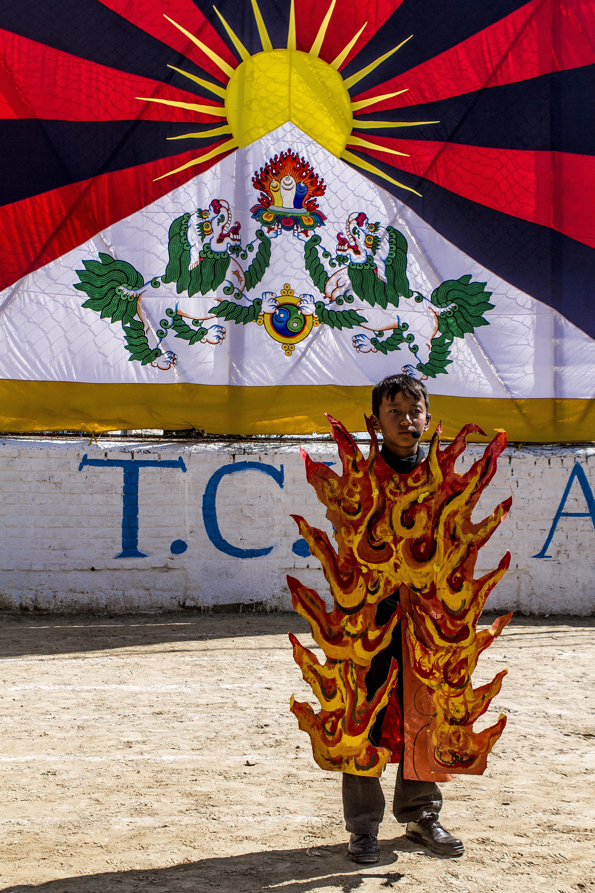 10 October, 2012 - Tibetan Children's Village School, McLeod Ganj   A young Tibetan student dressed as a self-immolating 'martyr' awaits his turn in a school performance which recounts the Chinese occupation of Tibet.