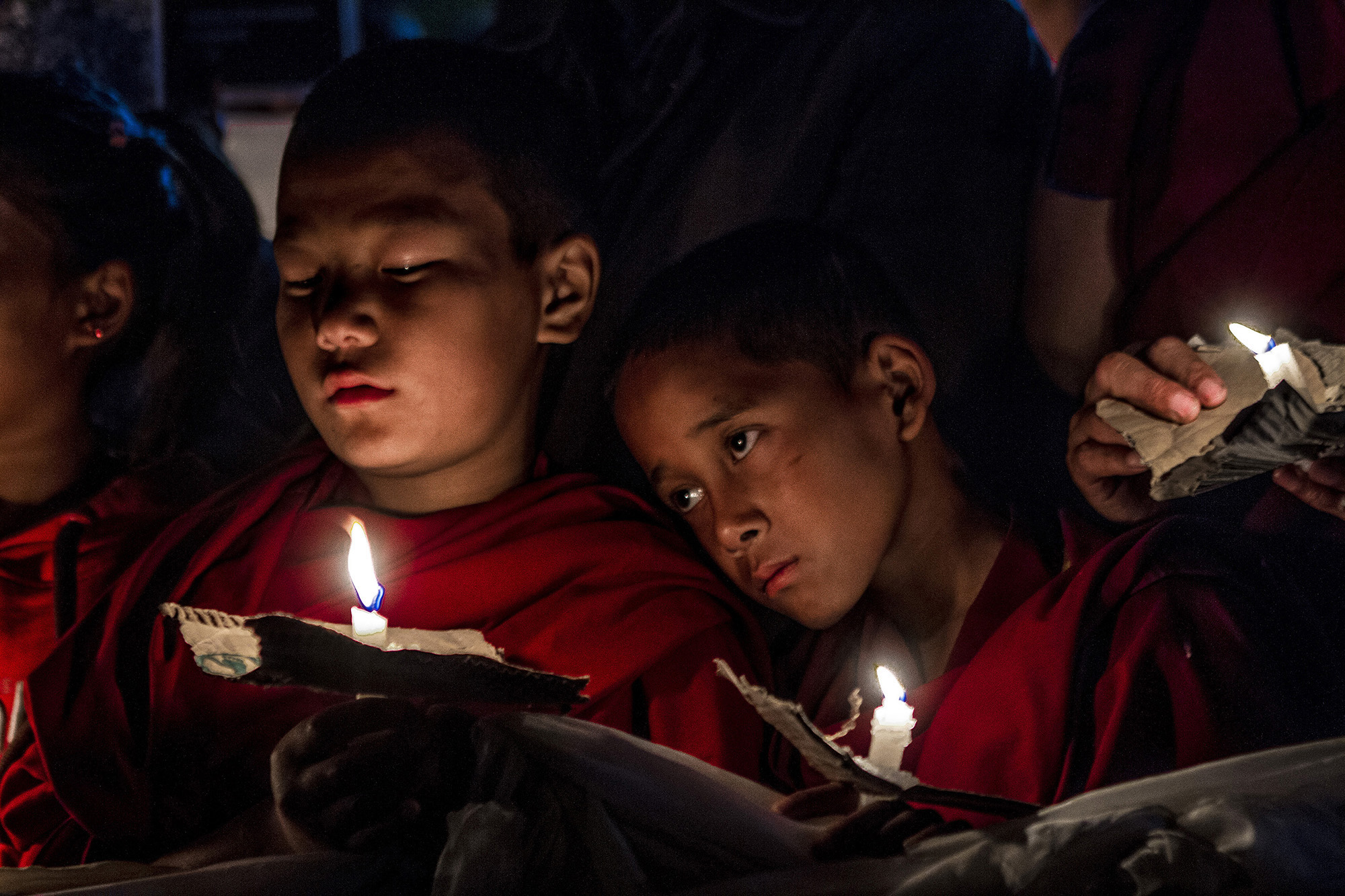 26 October, 2012 – Martyrs Memorial, Tsuglagkhang Temple, McLeod Ganj   Young Tibetan monks attend a candlelight vigil following the news of three more self-immolations in Tibet.