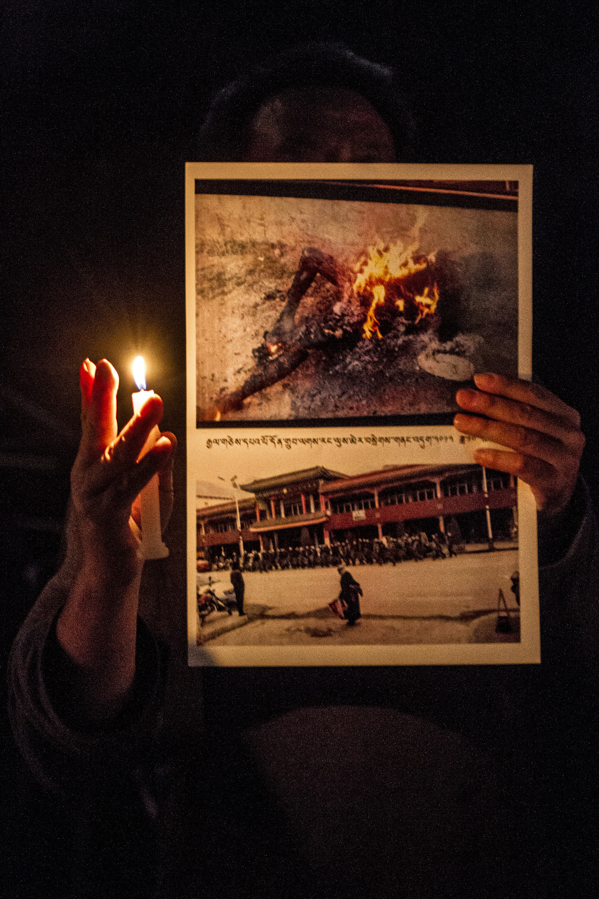 Normal   0           false   false   false     EN-US   X-NONE   X-NONE                                                                                 22 October, 2012 – Tibetan Childrens Village School, McLeod Ganj   A Tibetan protestor holds images of 61 year old Dhondup who set himself alight in Labrang, Tibet.  Dhondup's self-immolation was the 57th in ongoing protests against the Chinese occupation of Tibet.