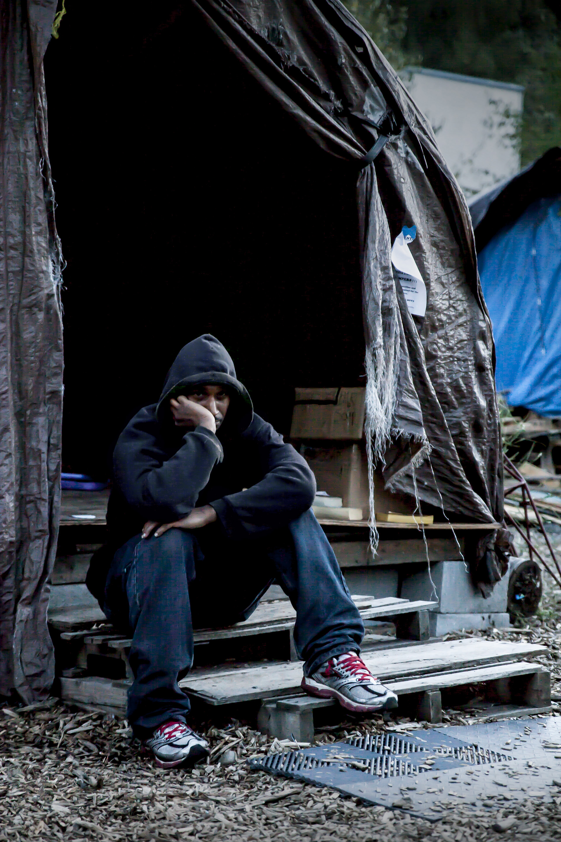 """31 August, 2013 - """"Nickelsville"""", Seattle   Nickelsville resident by the main supply tent where donated and shared food, water and other provisions are stored, on the eve of the City of Seattle's deadline for all residents to abandon the camp site."""