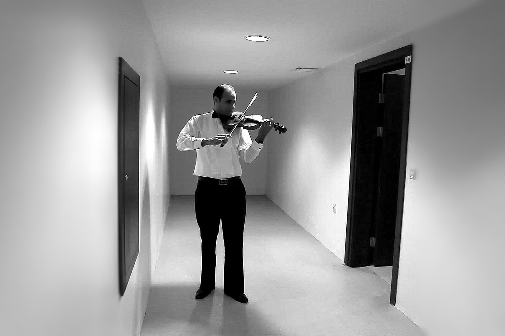 15 September, 2012 - Erbil, Iraqi Kurdistan   First Chair violinist Saad Al-Saedi warming up in the corridors of Saad Abdullah Palace Conference Centre prior to performance