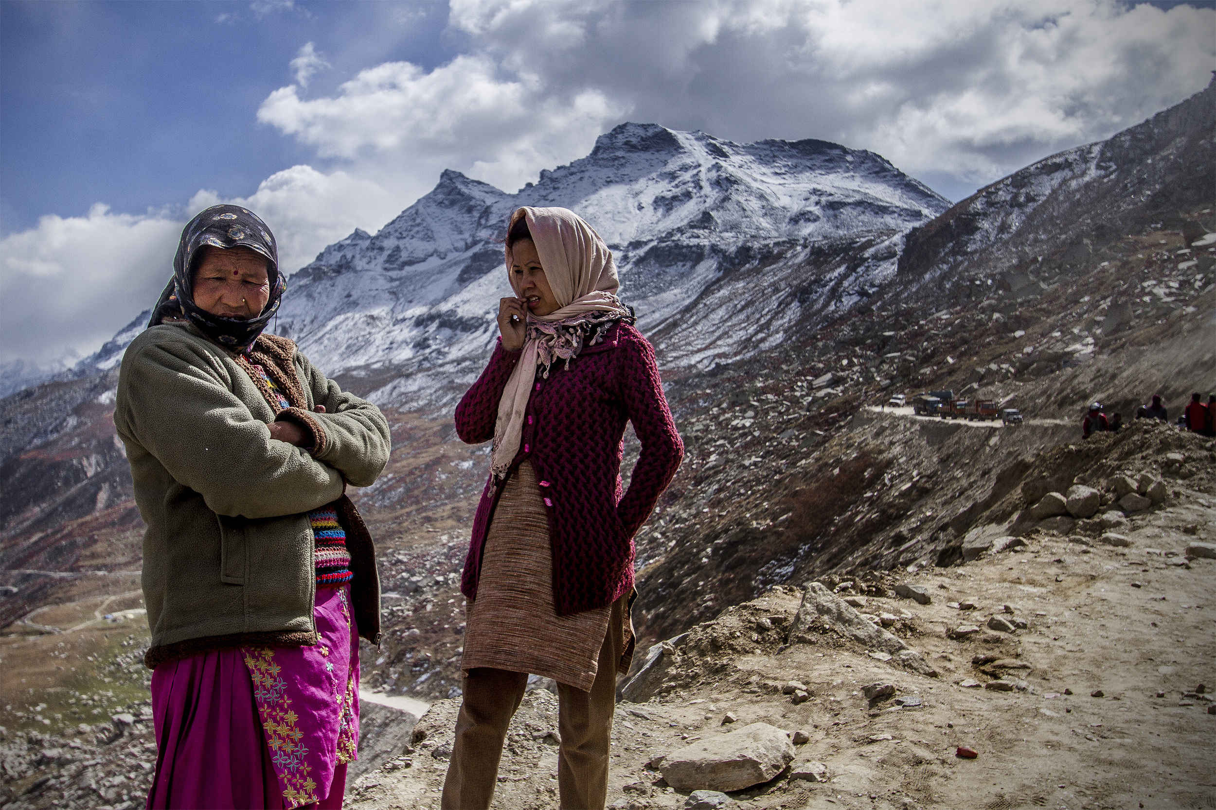 13 October, 2012 - Ascent to Rohtang Pass   Spiti women wait several hours for the road to clear after a small landslide.