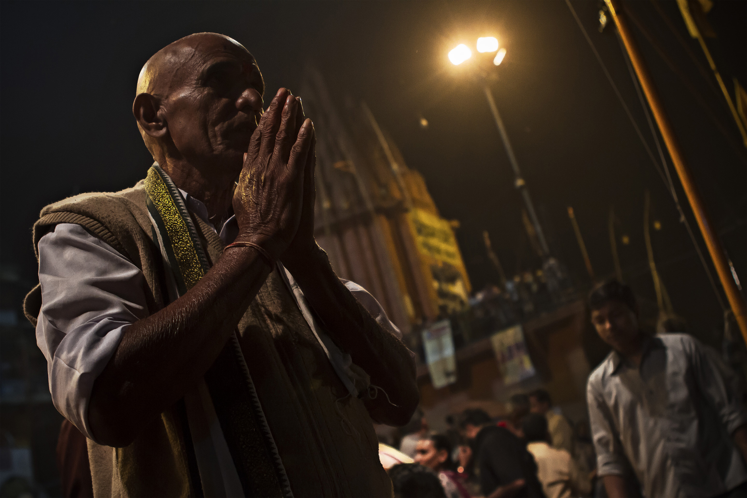 14 November, 2012 - Dashashwamedh Ghat, Varanasi   A devotee prays facing the Ganges at the conclusion of the nightly Ganga Aarti Ceremony