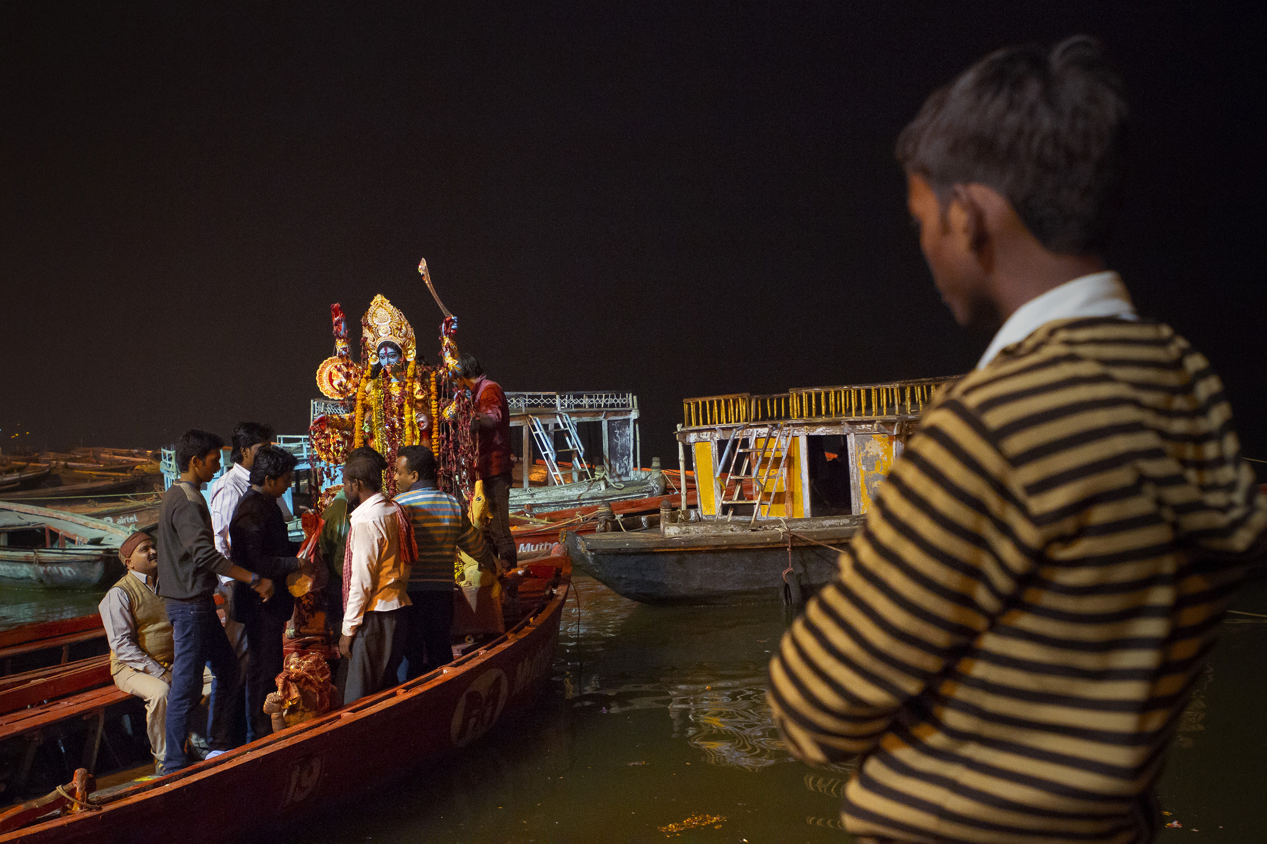 14 November, 2012 - Dashashwamedh Ghat, Varanasi   Kali Puja. Families purchase and decorate large plaster statues of the god Kali in their homes before parading it to the banks of the Ganges where it tossed from a boat into the river