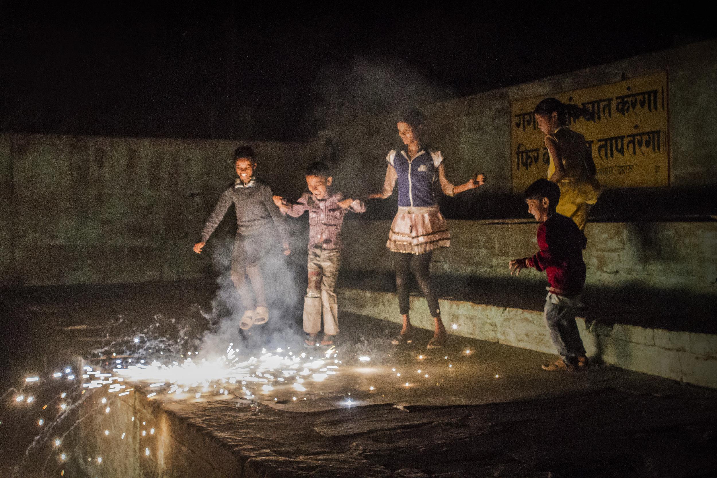 13 November, 2012 - Varanasi   Children celebrate Diwali with fireworks on the banks of the Ganges