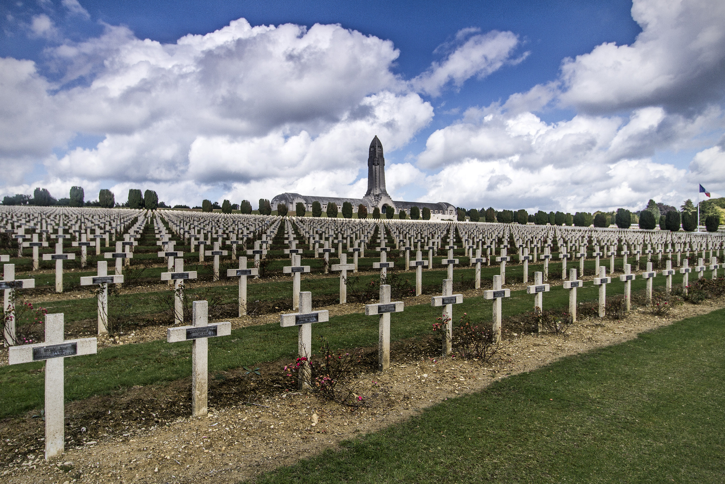 Normal   0           false   false   false     EN-US   X-NONE   X-NONE                                                                                 L'ossuaire de Douaumont   L'ossuaire de Douaumont, the single largest French military cemetery of the First World War with 16,142 graves, the majority from the 300 day 'Battle of Verdun' in 1916. In the Ossuary itself the skeletal remains of another 130,000 unidentified French and German soldiers can be viewed through small windows at the buildings rear.  The design of the building itself is based upon the hilt of a sword plunged into the earth with the skeletal remains beneath it forming the blade.
