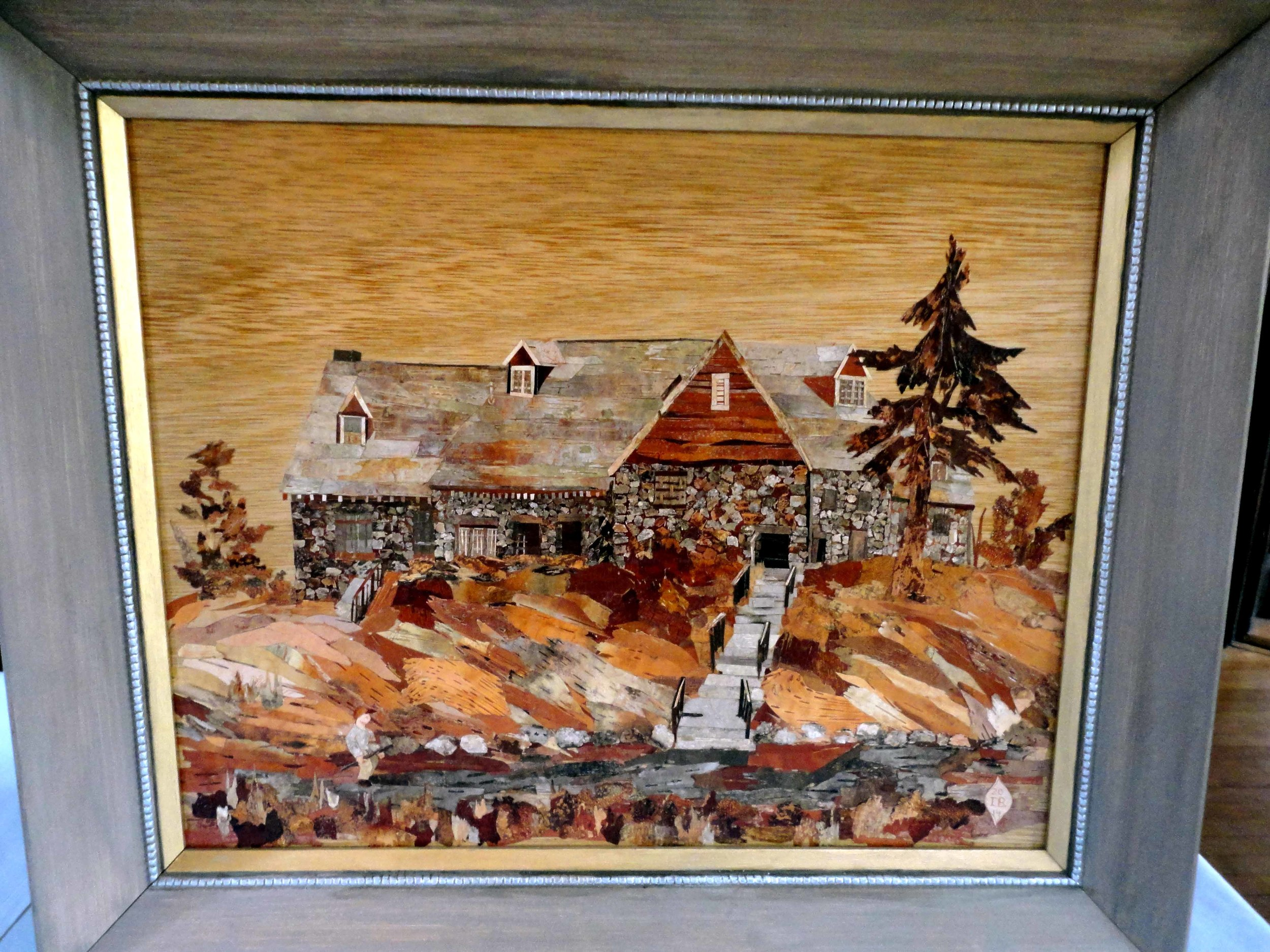 Mosaic picture of the Mount Hood Clubhouse made from different pieces of birch bark collected at Mount Hood and made by Inge Jewell of Melrose.