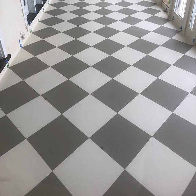 Here's a painted Diamond pattern on a porch floor which was sanded and the then triple coated with an off white stain. The floor was then masked off and a darker stain was applied to make the diamonds. The entire floor was finished with 3 coats of polyurethane. Should be able to handle those beach resort summers for awhile! #Ben Moore solid coat stains and polyuerethane#wallcoveringinstallersassociation