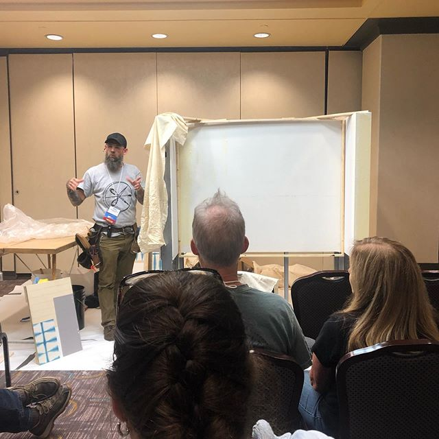 Jeff Ragland explains how to install muslin on a wall to prepare for scenic murals such as Zuber and Gracie murals at the 2019 WIA convention here in Cincinnati.