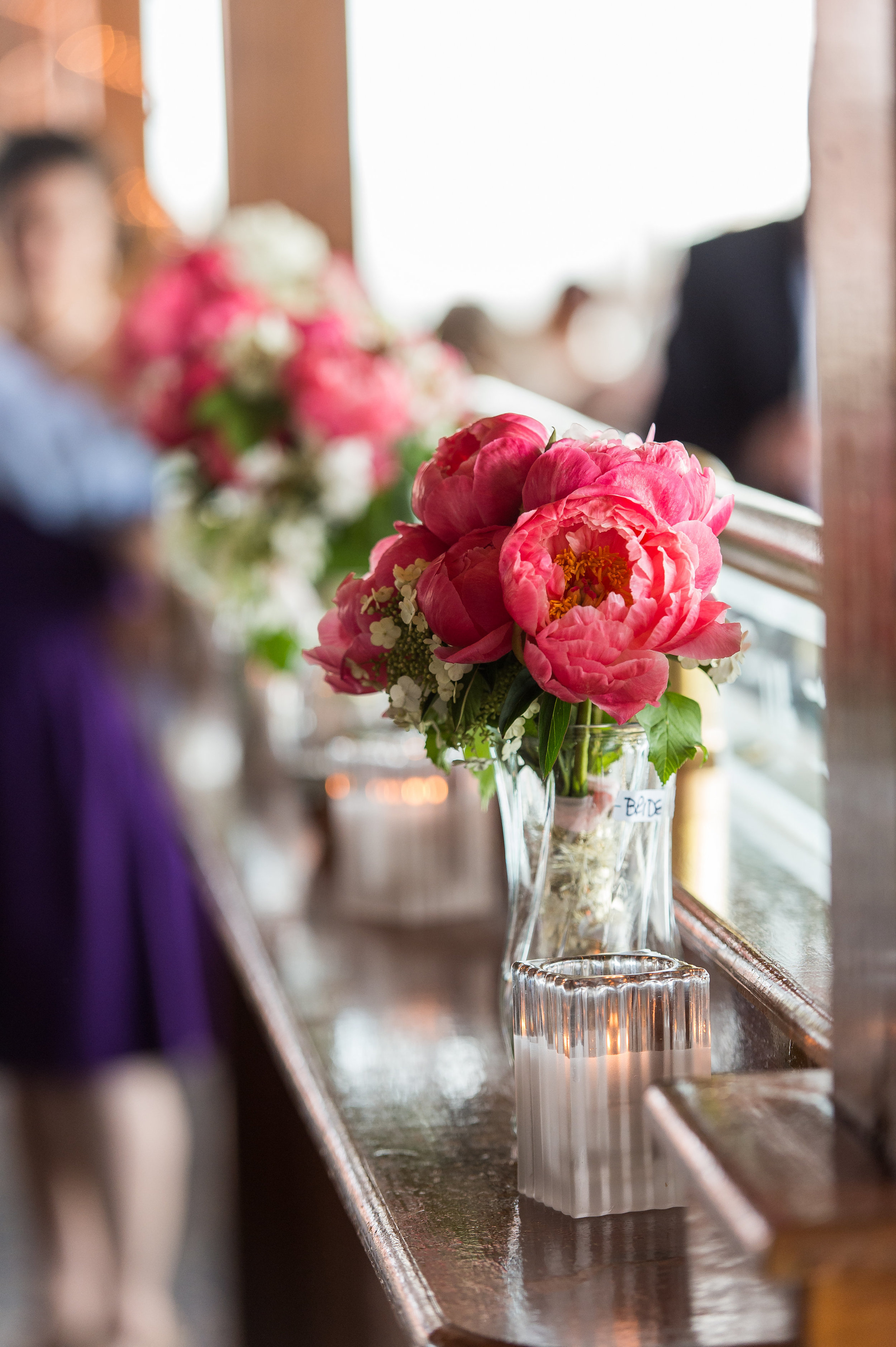 What a pretty pop of color. The bouquets are used for decoration after the I Do's.