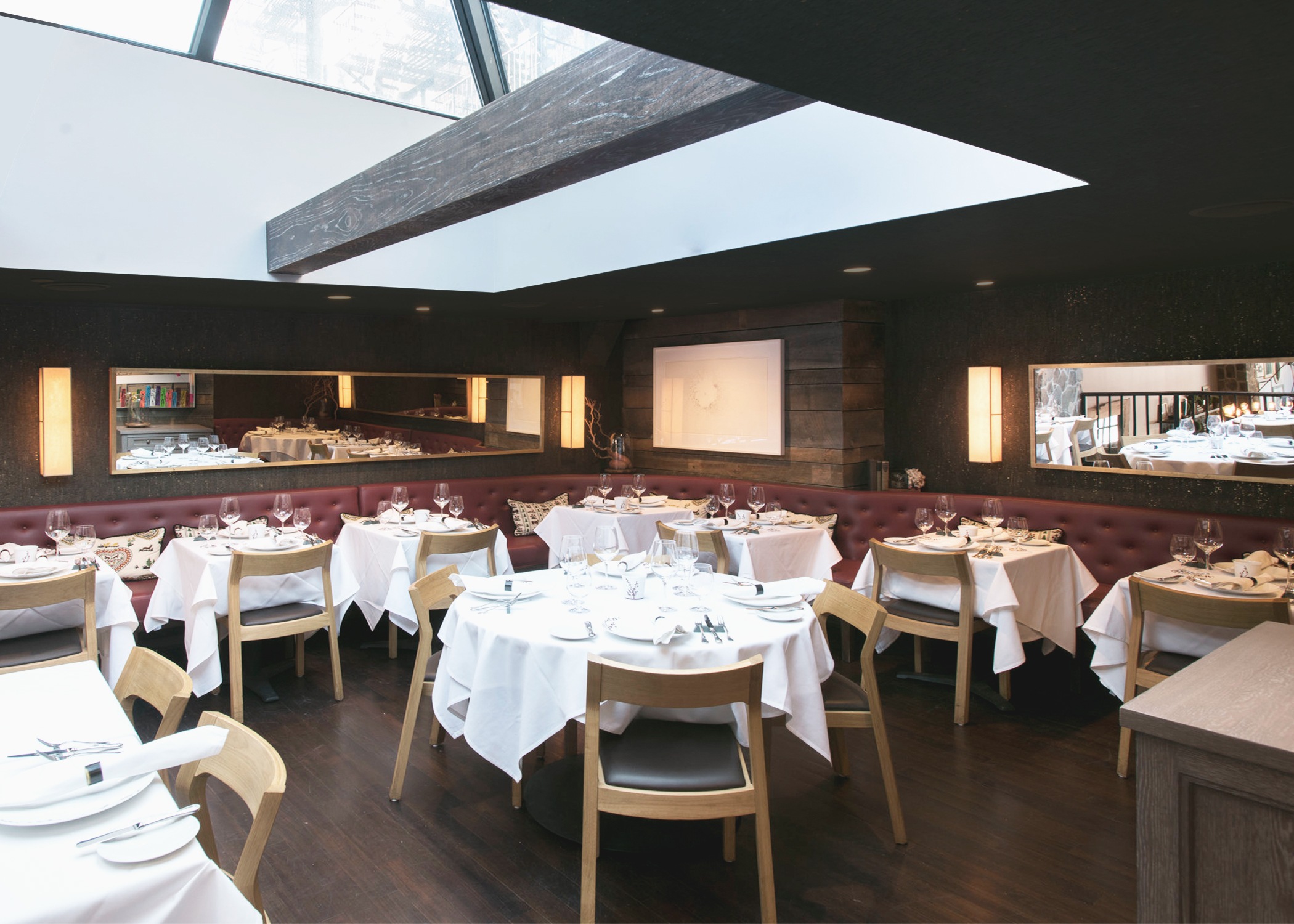 The Upstairs Dining Space Features a Large Skylight and Dark Cork Wall-Covering Flecked with Gold, both Improving Acoustics and Softening the Space