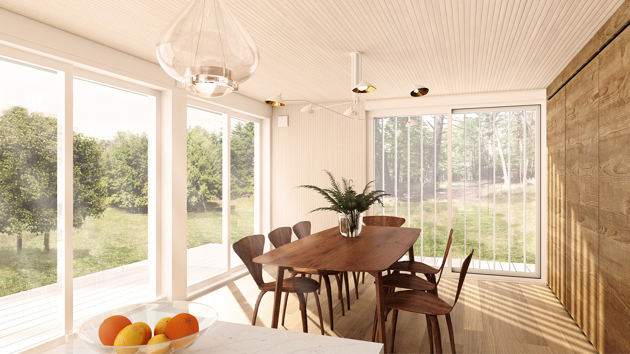 The Dining Area has full-height cabinetry and glazing with views down towards the pond and flanking rocky ridges