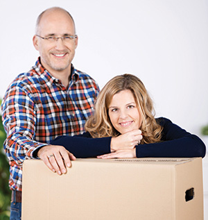 couple-taking-a-break-from-packing-up-the-house-web.jpg
