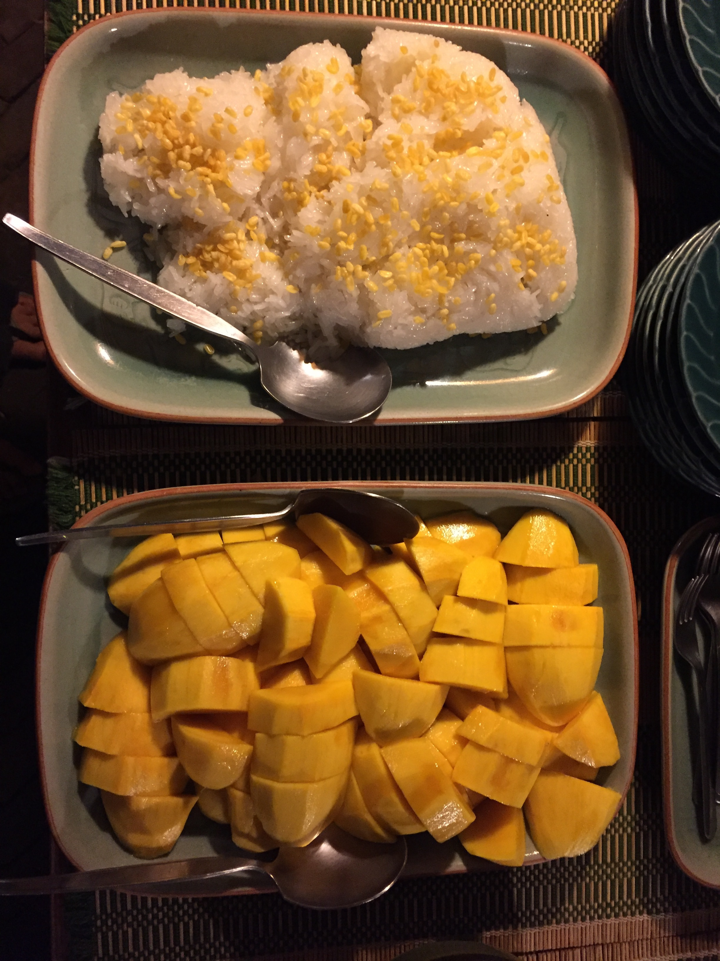 Mangoes picked straight from the tree and sticky rice topped with coconut cream and toasted nuts