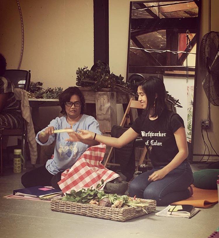 Ma and me exchanging lemongrass; photo courtesy of Tanya Suzuki