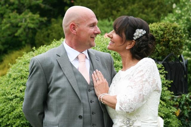 Bride wears the Flamenco hair comb & bespoke brooch design on the waist of the dress.