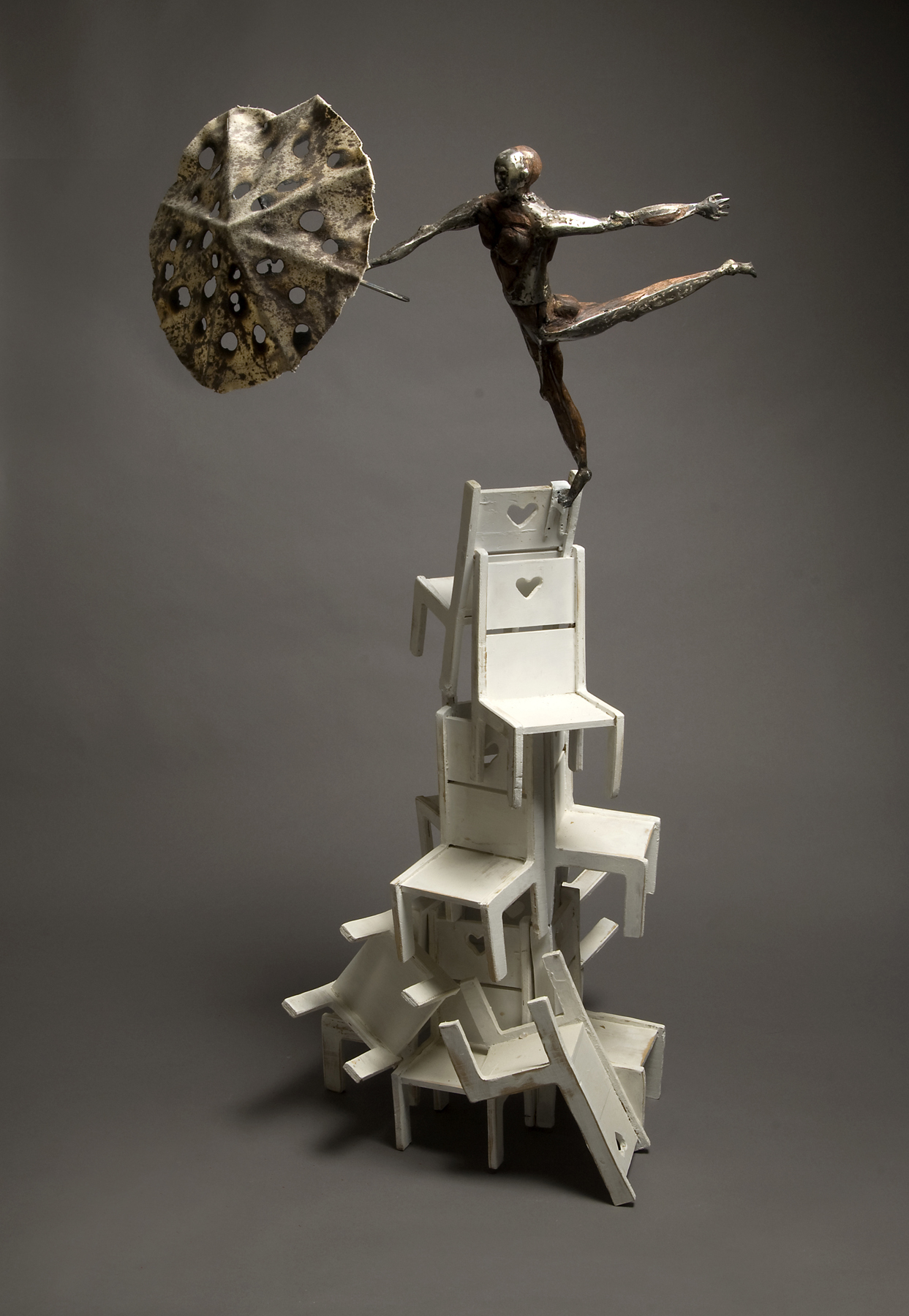 "Tolley Marney's sculpture, Harmony is hand forged steel, oak, pine and cloth. Dimensions: 48"" tall."