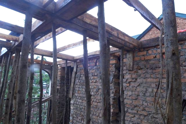 New walls constructed and the roof beams put in