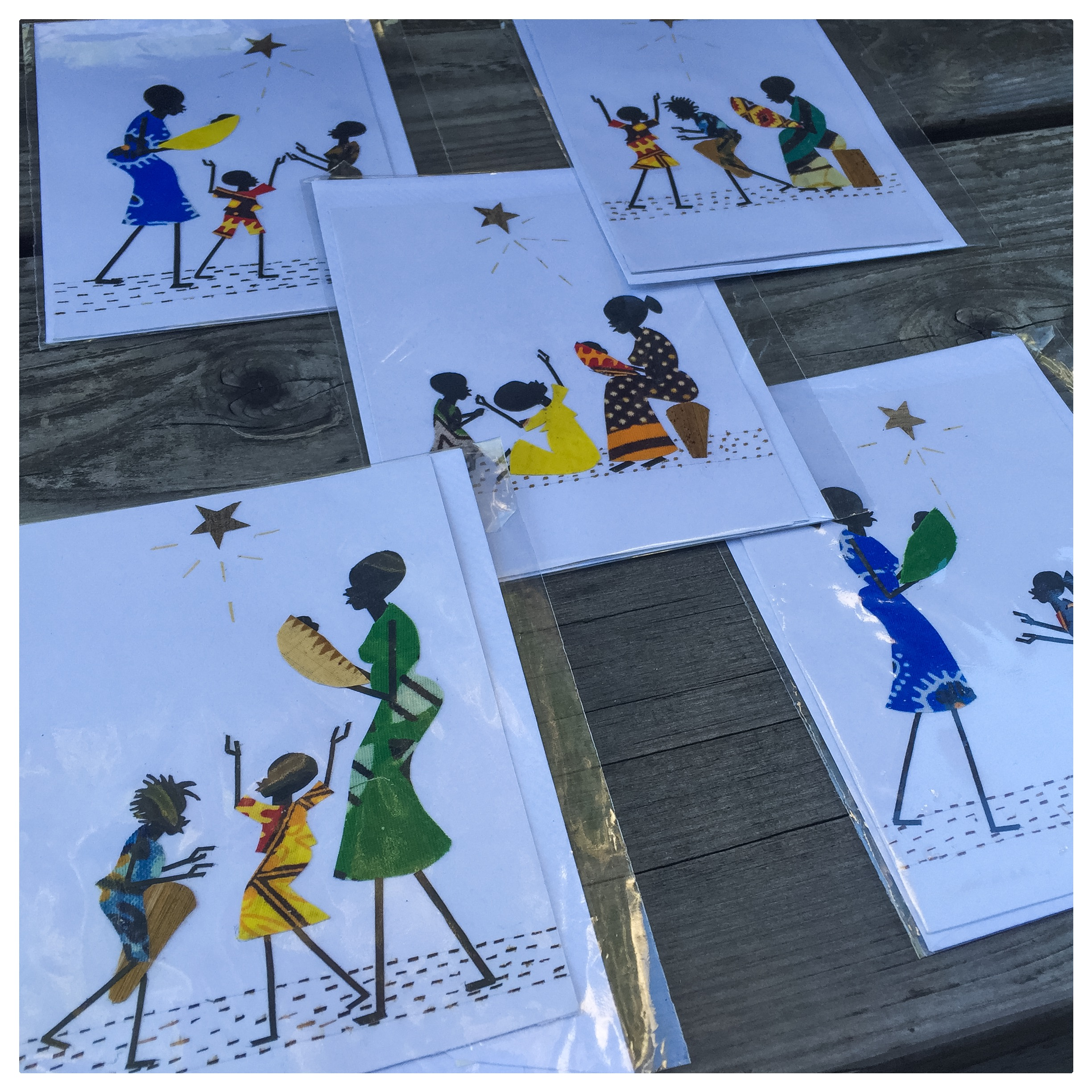 Mixed media textiles are used in these unique handmade Christmas cards. Handmade in Tanzania. The set includes 5 cellophane wrapped cards with envelopes.