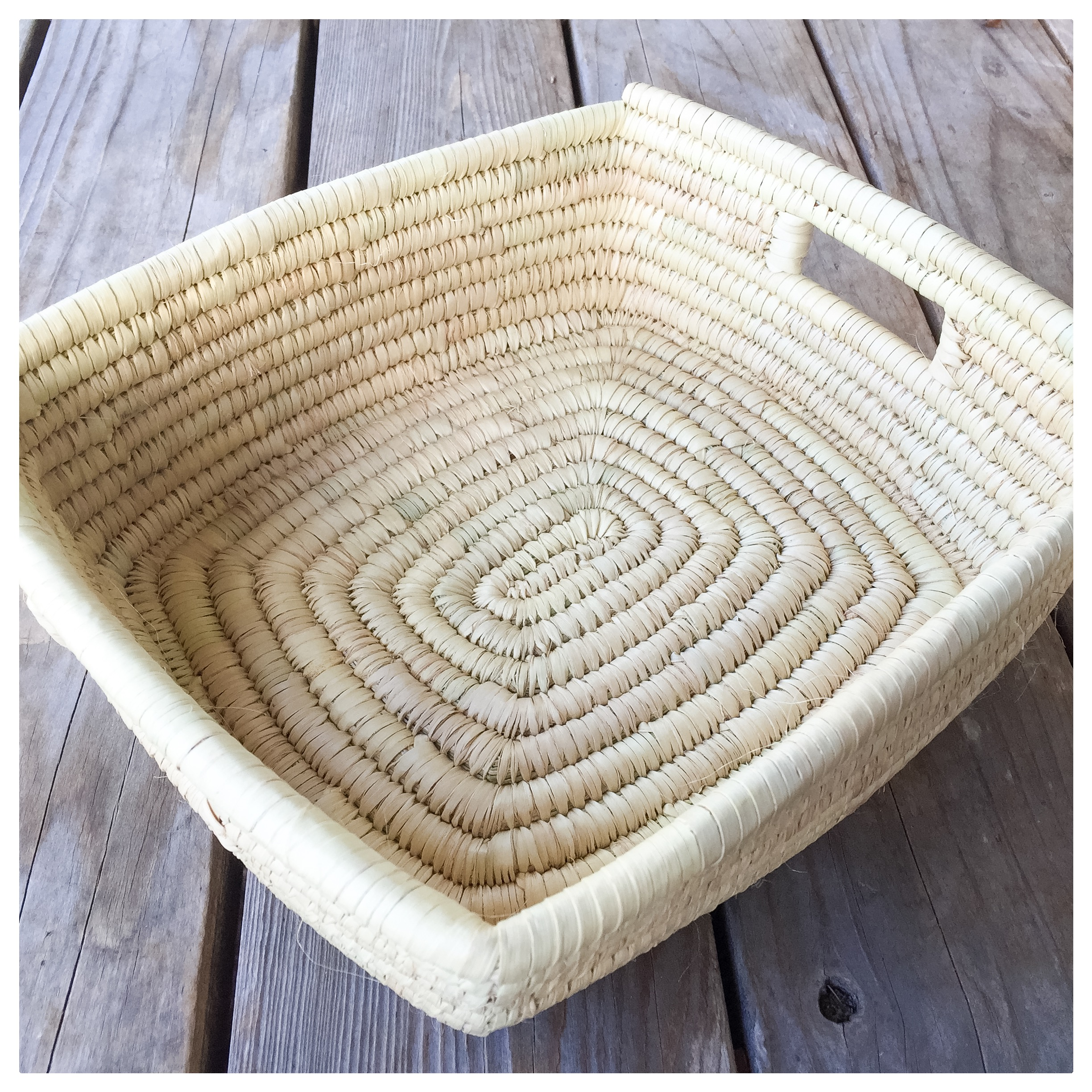 "Made in Tanzania, this basket is both functional and decorative. It measures 11"" x 12"" and is made from woven grass."
